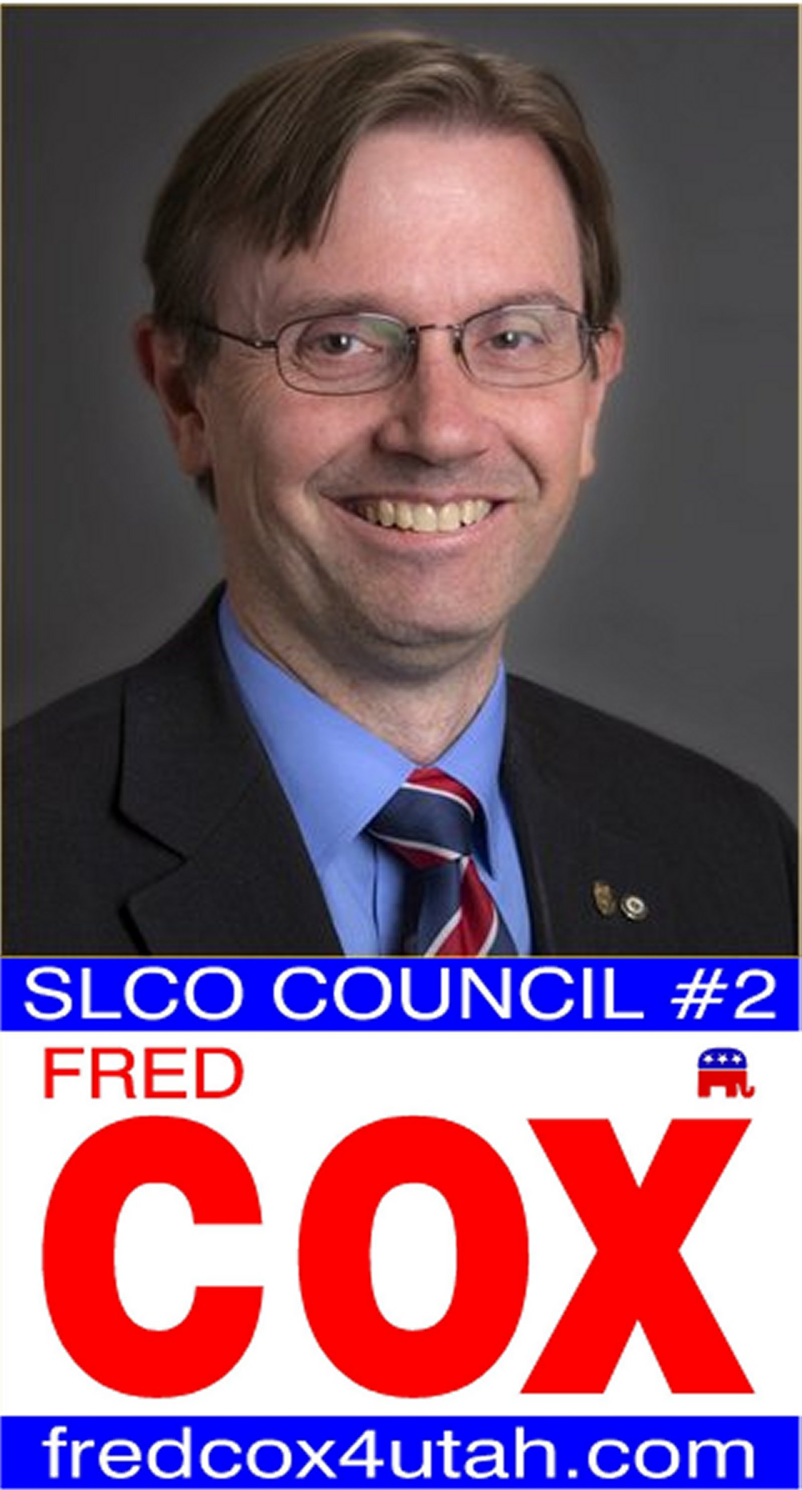 Photo of Fred C. Cox       and Sign for SLCO Council 2
